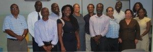 Some members of the NSC present at the signing ceremony. The NPC and NPC Assistant, Dr. Sylvester Lynch and Ms Cherese Jack, respectively are first and second from left in the front row