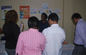 Ms Cherese Jack the NPC Assistant, in conversation with attendees at the National Nutrition Fair